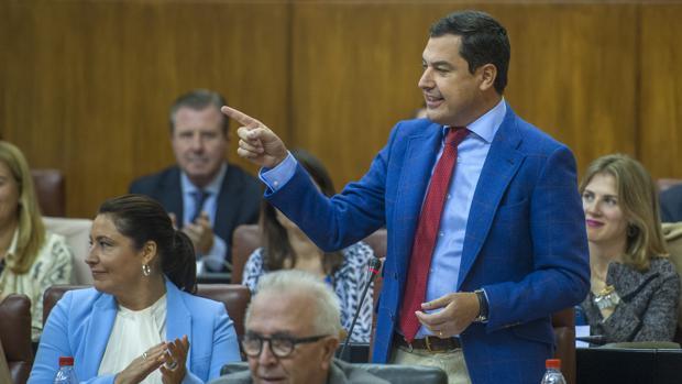 El presidente del PP andaluz y portavoz parlamentario, Juanma Moreno