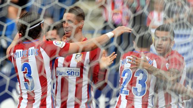 Los jugadores del Atlético celebran un gol en la victoria ante el Sporting
