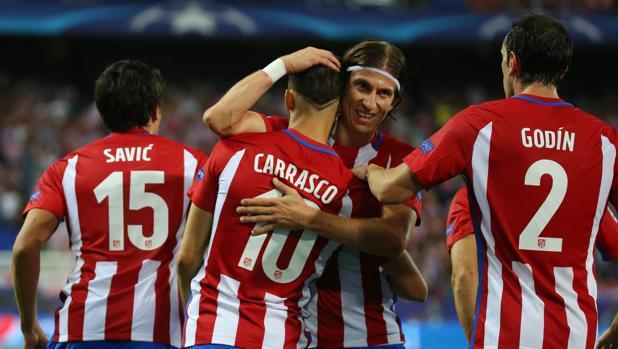 Los jugadores del Atlético celebran el gol de Carrasco ante el Bayern