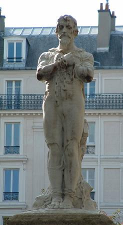 Estatua de Miguel Servet maniatado a la estaca de la hoguera, en la plaza Aspirant Dunand de París
