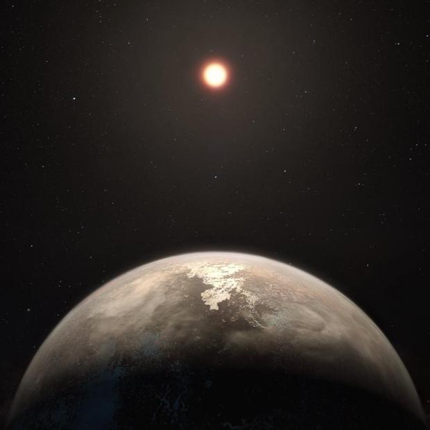 El planeta templado Ross 128 b, con su estrella madre enana roja de fondo