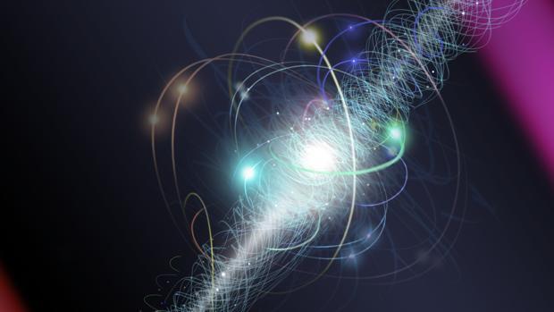 En esta representación artística, un electrón orbita el núcleo de un átomo, girando alrededor de su eje mientras una nube de otras partículas subatómicas se emiten y reabsorben constantemente