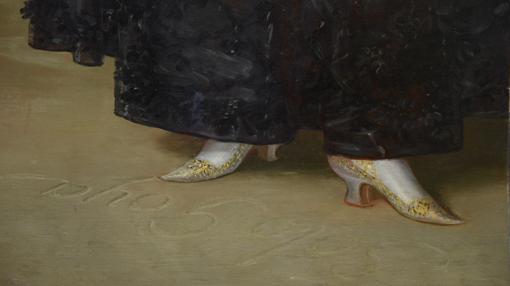 En la restauración del 59 se descubrió la palabra «Solo», oculta en el suelo del lienzo, junto a «Goya»
