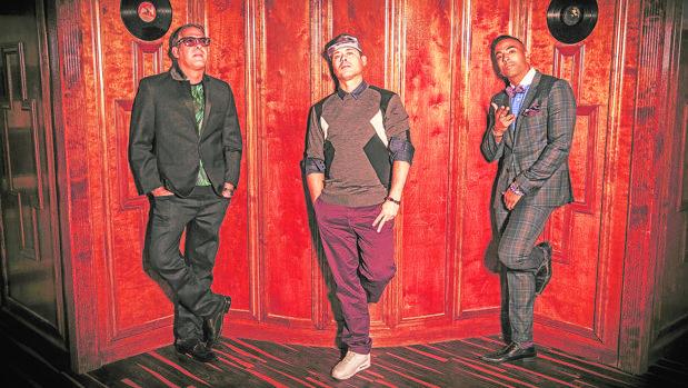 Los tres miembros de Orishas: Roldán, Ruzzo y Yotuel