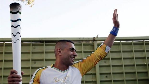 Ibrahim Al Hussein, cuando portó la antorcha olímpica al paso por su campo de refugiados
