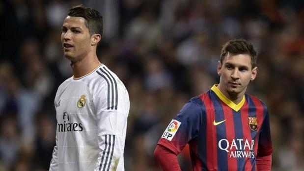 Cristiano Ronaldo y Messi, en un Clásico de la temporada 2013-2014