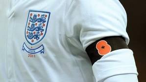 Duras críticas de Theresa May a la FIFA por prohibir la amapola