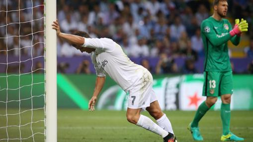 Cristiano y Oblak en la final de Milán