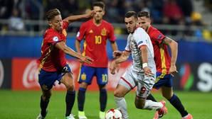 Marcos Llorente, Saúl y Denis Suárez durante el partido de España ante Macedonia.