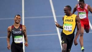 De Grasse, con Bolt, en los Juegos Olímpicos de Río 2016