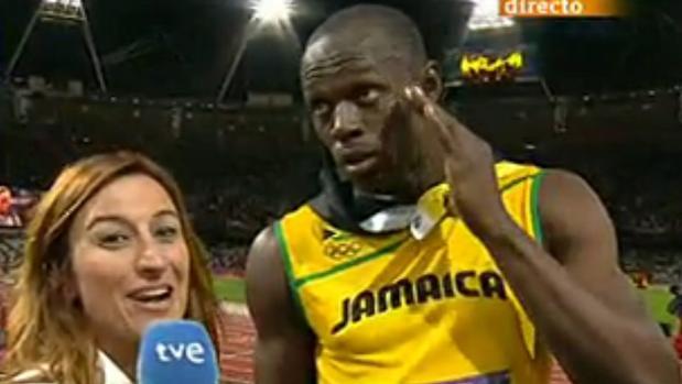 Usain Bolt con la periodista de TVE