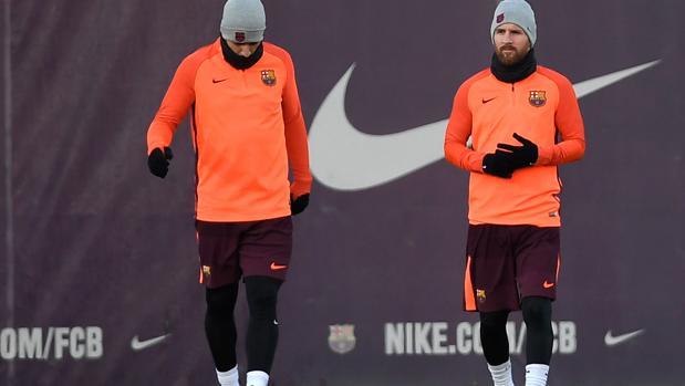 Luis Suárez y Leo Messi durante un entrenamiento