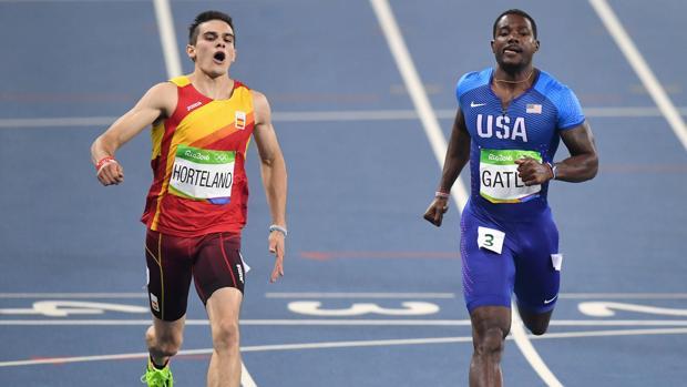 Bruno Hortelano y Justin Gatlin durante la prueba de los 200 de Río 2016