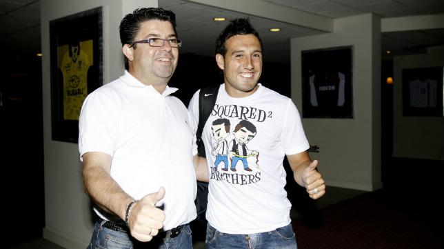 Antonio Fernández, con Cazorla en su etapa en el Málaga.