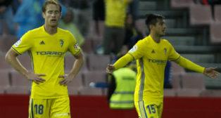 Álex y Mauro se lamentan tras perder en Granada hace un año.