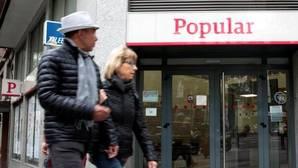 El Banco Popular reducirá sus direcciones territoriales y cerrará 302 sucursales