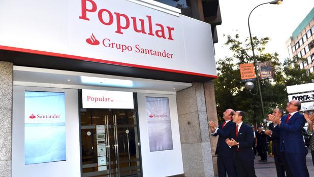 Banco santander comienza la integraci n con el popular con for Oficinas santander granada