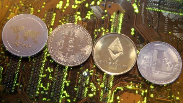 Representaciones de las criptomonedas ripple, bitcoin, ethereum y litecoin