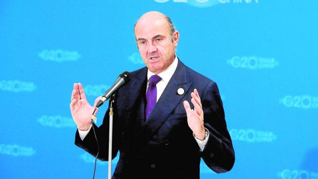 El ministro de Economía en funciones, Luis de Guindos, compareciendo en el G20