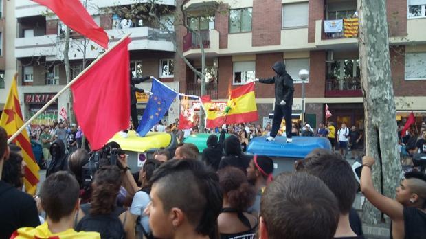 Un momento de la acción, durante la manifestación anticapitalista