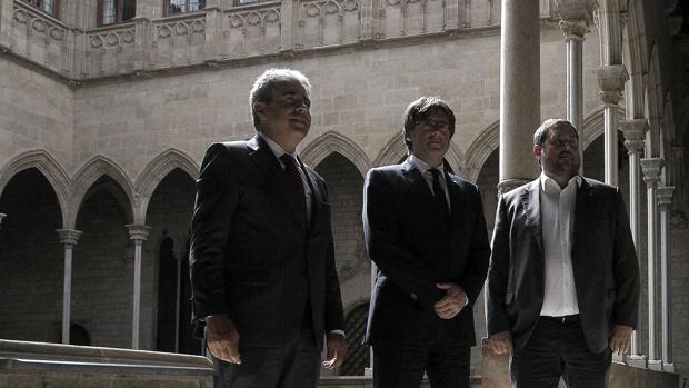 Homs, Puigdemont y Junqueras, esta mañana en el Palau de la Generalitat