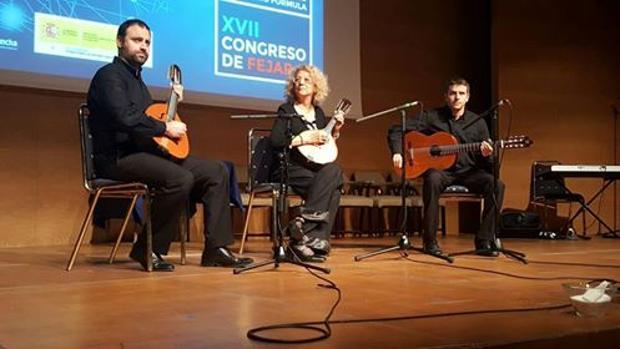 El trío, durante el concierto de clausura del congreso