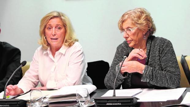 Concepción Dancausa y Manuela Carmena, en una reunión de la Jutna de Seguridad