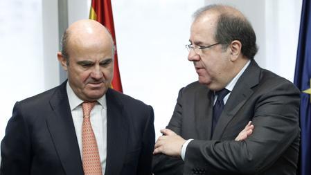 Herrera conversa con el ministro De Guindos