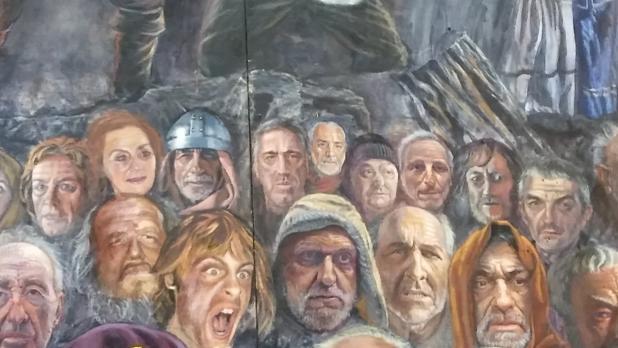 Detalle de la obra. El alcalde de Pamplona, en el centro de la última fila
