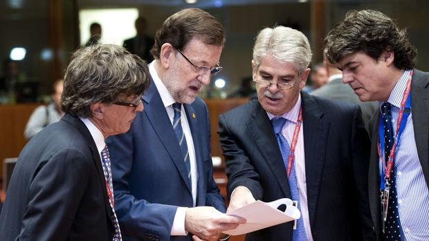 Rajoy junto a Dastis
