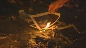 El fiscal pide que se impute a un concejal de una marca de Podemos por quemar fotografías del Rey en la Diada