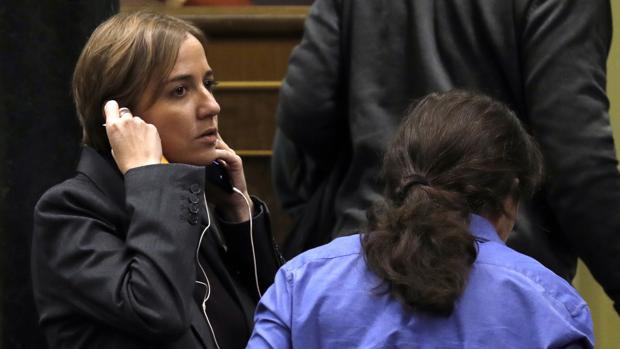 Tania Sánchez, diputada nacional, junto a Pablo Iglesias en el Congreso