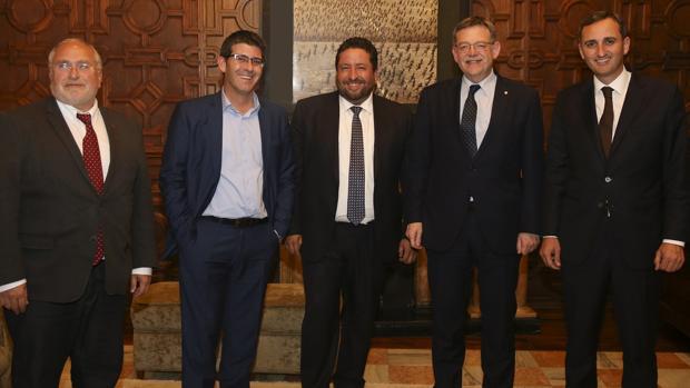 Los tres presidentes de las diputaciones de Alicante, Castellón y Valencia, con Puig en el Palau
