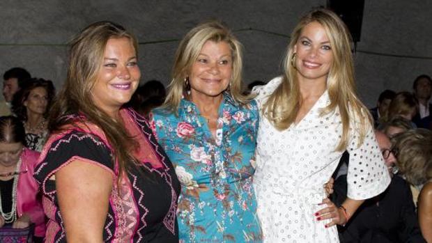 Cari Lapique y sus hijas