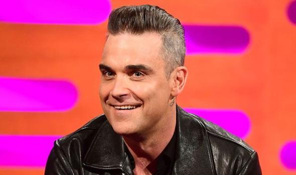 Robbie Williams tras sus operaciones de estética