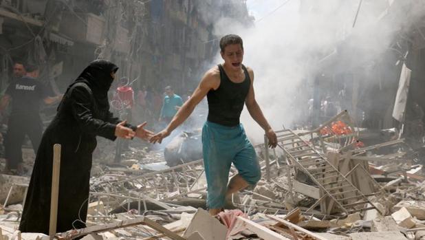 Imagen de archivo de un barrio de Alepo tras la caída de una bomba