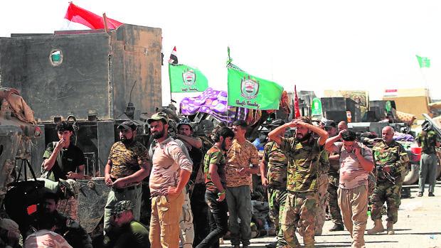Miembros de las Unidades de Movilización Popular (milicias chíes), ayer tras recuperar Tal Afar