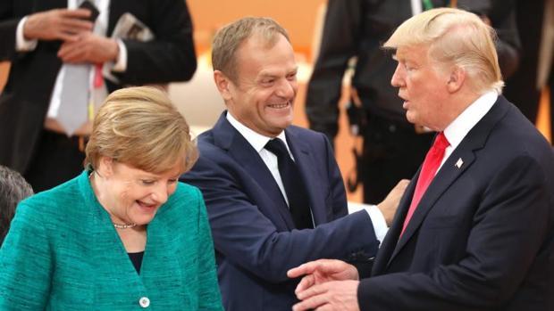 Angela Merkel, Donald Tusk y Donald Trump en una reunión del G20