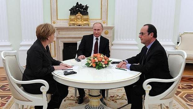 Merkel, Putin y Hollande, durante una reunión en el Kremlin