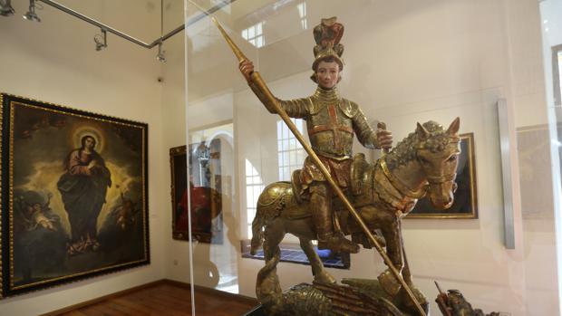 San Jorge y el dragón, que pueden contemplarse en el Hospital de la Caridad