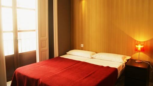 Habitación doble en el Oasis Bakcpacker´s Palace Sevilla. Fuente: hostelsoasis.com